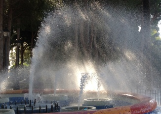 A park fountain takes on a new dimension in the wind